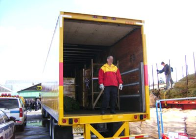 DHL Employee in Truck for Trees for Troops